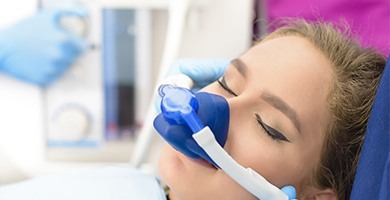 Relaxed woman with nitrous oxide nasal mask